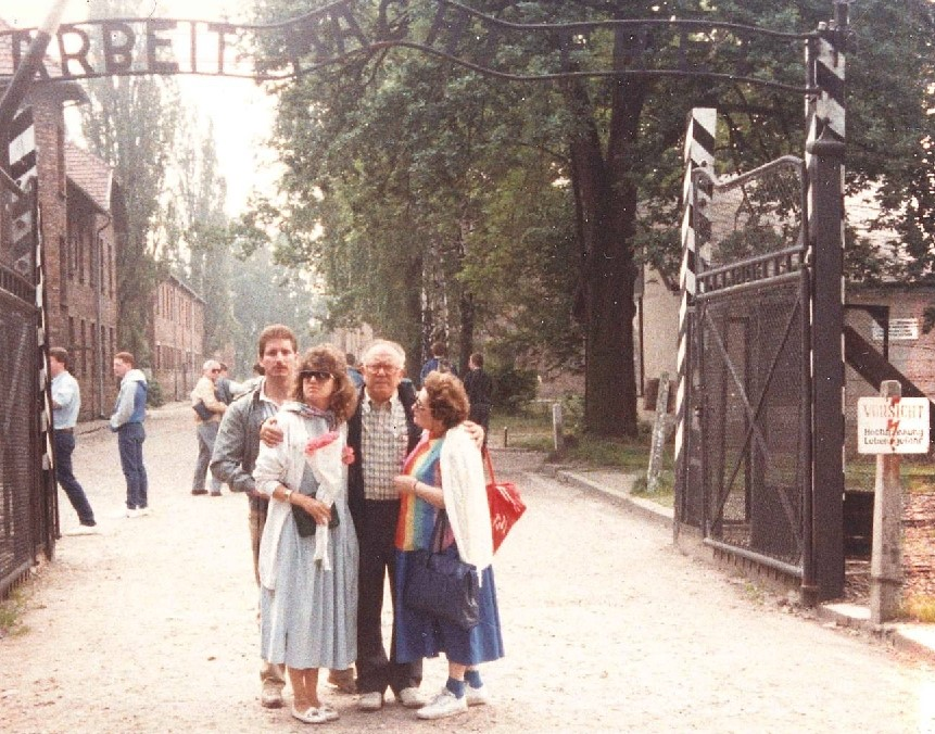 Kolender Family at the entrance to Auschwitz